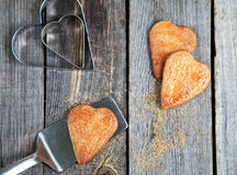 Golden Heart shaped cookies with a sugar crust on wooden table w Royalty Free Stock Images