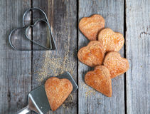 Golden Heart shaped cookies with a sugar crust on wooden table w Stock Images
