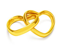 Golden heart shaped rings. Heart shaped rings on white background Royalty Free Stock Photos
