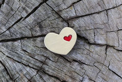 Golden Heart with Small Red Heart on Wood Royalty Free Stock Image