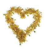 Golden heart from tinsel. Royalty Free Stock Images