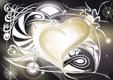 Golden heart with tribal designs. Spiral and shining Royalty Free Stock Photos