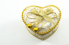 Golden heart on a white background Stock Images