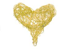 Golden heart from wire. Isolated on the white background Royalty Free Stock Image