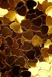 Golden hearts background Stock Images