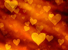 Golden hearts backgrounds. Love symbol texture Royalty Free Stock Image