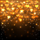 Golden hearts on dark background Royalty Free Stock Images