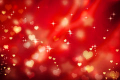 Golden hearts on red background. Golden small hearts on red background with stars Royalty Free Stock Images