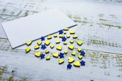 Golden hearts and small blue flowers in an envelope on a lilac background. Valentine`s Day. love concept Gift, message for lover stock images