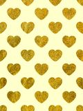 Golden hearts on a yellow background. The theme of love and Valentines Day. Beautiful festive shiny pattern. Rectangular vertical orientation Stock Photo
