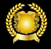 Golden heraldic shield with laurel wreath Stock Images