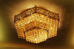 Golden hexagon lamp. Golden hexagon pendant lamp on ceiling of a luxury restaurant stock images