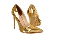 Golden high heel women shoes. Isolated on white Stock Photos