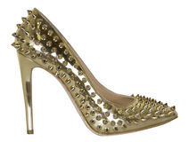 Golden  high  heeled shoes Royalty Free Stock Images