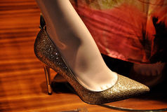 Golden high heels. Golden elegant high heels in the store window royalty free stock photos