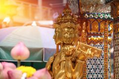 Golden Hindu god Brahma statue be enshrined on altar. Beautiful Indian religion traditional lord sculpture. The creator god in Hinduism, who forms a triad with Royalty Free Stock Photo