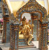 Golden Hindu god Brahma statue be enshrined on altar. Beautiful Indian religion traditional lord sculpture. The creator god in Hinduism, who forms a triad with stock image