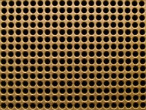Golden holes. Futuristic golden hole grid making an abstract pattern Stock Image