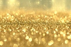 Gold glitter background, Golden Holiday Abstract Glitter Defocused Background With Blinking Stars. Christmas Background. royalty free stock images