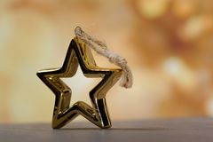 Golden holiday abstract glitter defocused background royalty free stock photography