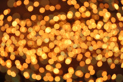Golden holiday background. Glittering defocused lights, golden background Stock Photos