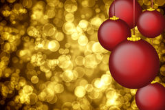 Golden holiday background with christmas ornaments Stock Image