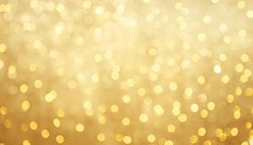 Beautiful golden bokeh background. Golden Holiday bokeh background with copy space. Texture for design invite for happy New year's or Christmas, Birthday Stock Photography
