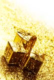 Golden holiday gifts. On shiny glitter background Royalty Free Stock Photos