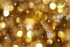 Golden holiday lights background. Christmas high contrast golden lights background with little stars Stock Photography