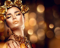 Golden holiday makeup. Fashion art hairstyle, manicure and makeup Royalty Free Stock Image