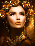 Golden holiday makeup. Golden wreath and necklace Royalty Free Stock Image