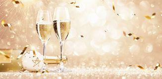Golden Holiday Party with Champagne royalty free stock photography