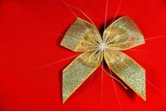 Golden Holiday ribbon Stock Photos