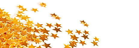 Golden holiday shiny little stars table ornaments on white, holiday header Royalty Free Stock Photo
