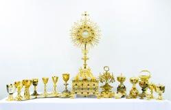 Golden holy religious equipment on white background stock photos