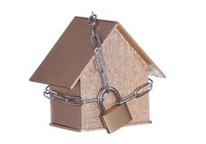 Golden home protected with padlock and chain Stock Image