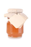 Golden honey jar Stock Photography