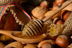 Golden honey and shelled fruits Royalty Free Stock Photos