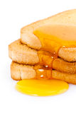 Golden honey on toast Royalty Free Stock Images