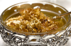 Golden Honeycomb in Bowl Stock Image