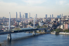 Golden Horn Metro Bridge with old and modern side of Istanbul background. View during the day time. Lots of building and sea view of Istanbul Royalty Free Stock Photos