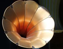 Golden horn of vintage gramophone. Close up stock photography