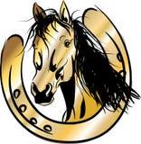 Golden horse with horseshoe Stock Image