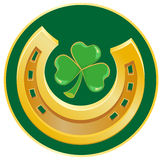 Golden Horseshoe and clover leaf. Symbol of good luck Stock Photos