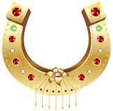 Golden Horseshoe decorated with precious stones and flowers Stock Photography
