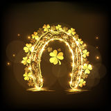 Golden horseshoe with shamrock leaves for St. Patrick's Day cele Stock Photography