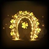 Golden horseshoe with shamrock leaves for St. Patricks Day cele Stock Photography