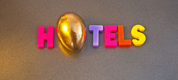 Golden hotels. Text ' hotel ' in colorful uppercase letters with the letter Royalty Free Stock Photography