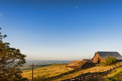 Golden Hour at The Dallas Mountain Ranch at Columbia Hills State. Dawn`s Light view of out buildings and vast landscape of The Dallas Mountain Ranch, a popular Stock Photography