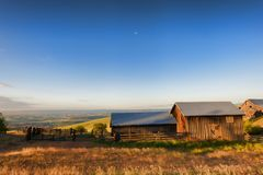 Golden Hour at The Dallas Mountain Ranch at Columbia Hills State. Dawns Light view of out buildings and vast landscape of The Dallas Mountain Ranch, a popular Stock Photo